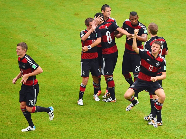 Thomas Muller of Germany celebrates scoring his team's first goal with teammates during the 2014 FIFA World Cup Brazil group G match between the United States and Germany at Arena Pernambuco on June 26, 2014