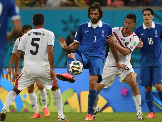 Greece's forward Georgios Samaras vies with Costa Rica's midfielder Celso Borges and Costa Rica's defender Oscar Duarte during a Round of 16 football match between Costa Rica and Greece at Pernambuco Arena in Recife during the 2014 FIFA World Cup on June
