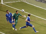 Costa Rica's goalkeeper Keylor Navas prepares to make a save as Greece's forward Kostas Mitroglou and defender Vasilis Torosidis try to score during the round of 16 football match between Costa Rica and Greece at Pernambuco Arena in Recife during the 2014