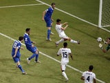 :Greece's defender Sokratis Papastathopoulos scores during a Round of 16 football match between Costa Rica and Greece at Pernambuco Arena in Recife during the 2014 FIFA World Cup on June 29, 2014