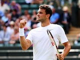 Grigor Dimitrov of Bulgaria celebrates a point during his Gentlemen's Singles first round match against Ryan Harrison of the United States of Austria on day one of the Wimbledon Lawn Tennis Championships at the All England Lawn Tennis and Croquet Club at