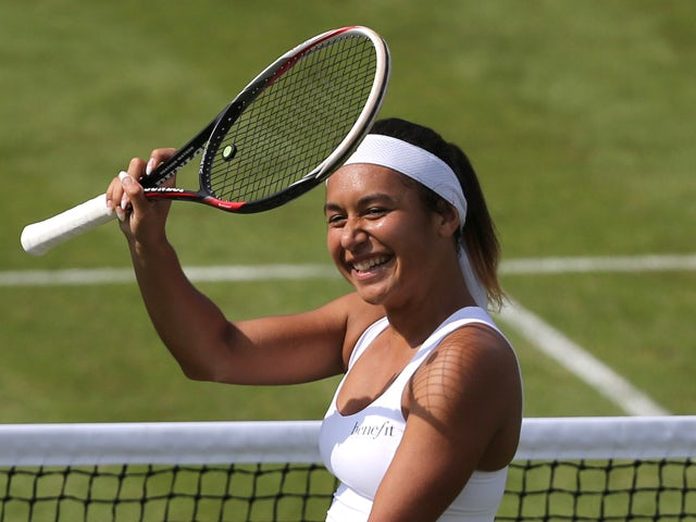 Britain's Heather Watson celebrates after winning her women's singles first round match against Croatia's Ajla Tomljanovic on day two of the 2014 Wimbledon Championships at The All England Tennis Club in Wimbledon, southwest London, on June 24, 2014