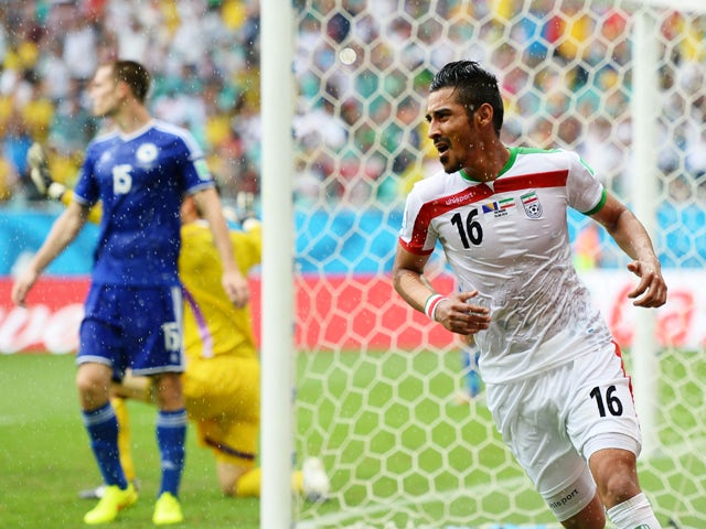 Reza Ghoochannejhad of Iran celebrates scoring his team's first goal during the 2014 FIFA World Cup Brazil Group F match between Bosnia and Herzegovina and Iran at Arena Fonte Nova on June 25, 2014