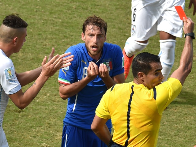 Italy's midfielder Claudio Marchisioreacts as he is shown a red card by Mexican referee Marco Antonio Rodriguez Moreno during a Group D football match between Italy and Uruguay at the Dunas Arena in Natal during the 2014 FIFA World Cup on June 24, 2014