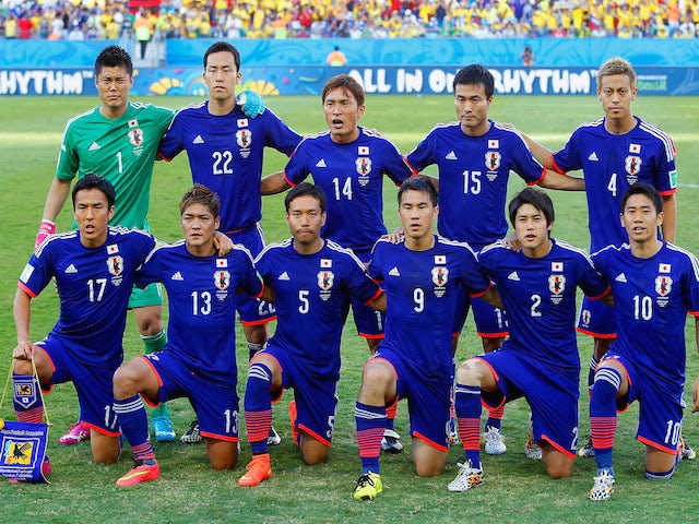 Japan players pose for a team photo during the 2014 FIFA World Cup Brazil Group C match between Japan and Colombia at Arena Pantanal on June 24, 2014