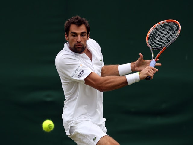 Jeremy Chardy of France plays a backhand during his Gentlemen's Singles first round match against Daniel Cox of Great Britain on day one of the Wimbledon Lawn Tennis Championships at the All England Lawn Tennis and Croquet Club at Wimbledon on June 23, 20
