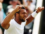 Jo-Wilfried Tsonga of France celebrates after winning his Gentlemen's Singles second round match against Sam Querrey of the United States on day four of the Wimbledon Lawn Tennis Championships at the All England Lawn Tennis and Croquet Club at Wimbledon o