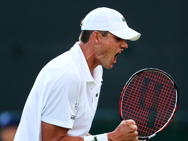 John Isner of the United States celebrates after winning his Gentlemen's Singles first round match against Daniel Smethurst of Great Britain on day two of the Wimbledon Lawn Tennis Championships at the All England Lawn Tennis and Croquet Club at Wimbledon