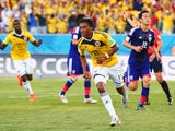 Juan Guillermo Cuadrado of Colombia celebrates scoring his team's first goal after a penalty kick during the 2014 FIFA World Cup Brazil Group C match against Japan on June 24, 2014