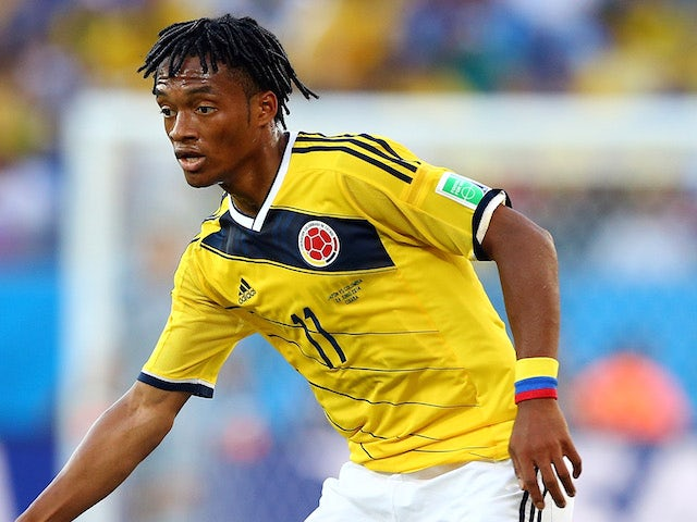 Juan Cuadrado of Colombia controls the ball during the 2014 FIFA World Cup Brazil Group C match between Japan and Colombia at Arena Pantanal on June 24, 2014