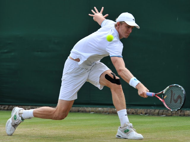 South Africa's Kevin Anderson returns against France's Edouard Roger-Vasselin during their men's singles second round match on day three of the 2014 Wimbledon Championships at The All England Tennis Club in Wimbledon, southwest London, on June 25, 2014