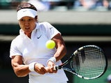 Li Na of China plays a backhand return during the Ladies' Singles third round match Barbora Zahlavova Strycova of Czech Republic on day five of the Wimbledon Lawn Tennis Championships at the All England Lawn Tennis and Croquet Club on June 27, 2014