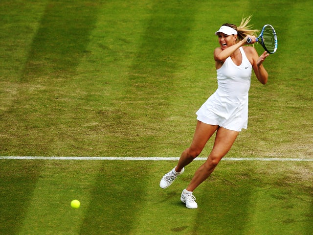 Maria Sharapova of Russia returns the ball during her Ladies' Singles second round match against Timea Bacsinszky of Switzerland on day four of the Wimbledon Lawn Tennis Championships at the All England Lawn Tennis and Croquet Club at Wimbledon on June 2