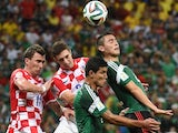 Croatia's forward Mario Mandzukic (L) and Croatia's defender Sime Vrsaljko (2nd L) vie with Mexico players during a Group A football match on June 23, 2014
