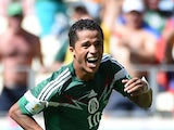 Mexico's forward Giovani Dos Santos celebrates after scoring during a Round of 16 football match between Netherlands and Mexico at Castelao Stadium in Fortaleza during the 2014 FIFA World Cup on June 29, 2014