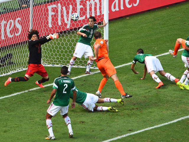 Goalkeeper Guillermo Ochoa of Mexico makes a save after a shot at goal by Stefan de Vrij of the Netherlands during the 2014 FIFA World Cup Brazil Round of 16 match between Netherlands and Mexico at Castelao on June 29, 2014