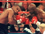 World Boxing Association heavyweight champion Evander Holyfield lands a right on challenger Mike Tyson during the first round of their fight in the MGM Grand Garden Arena 28 June, 1997