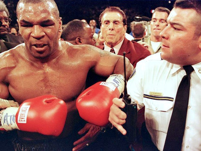 Mike Tyson is held back by police after his fight against Evander Holyfield 28 June, 1997