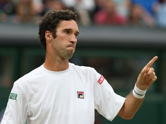 Kazakhstan's Mikhail Kukushkin reacts after a point against Spain's Rafael Nadal during their men's singles third round match at Wimbledon on June 28, 2014