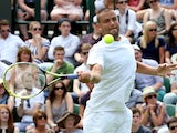 Mikhail Youzhny of Russia plays a forehand during his Gentlemen's Singles first round match against James Ward of Great Britain on day one of the Wimbledon Lawn Tennis Championships at the All England Lawn Tennis and Croquet Club at Wimbledon on June 23,