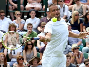 Result: Wang overcomes Youzhny in second round