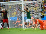Mexico's defender and captain Rafael Marquez and Mexico's goalkeeper Guillermo Ochoa react after the awarding of a penalty after a tackle on Netherlands' forward Arjen Robben during a Round of 16 football match between Netherlands and Mexico at Castelao S