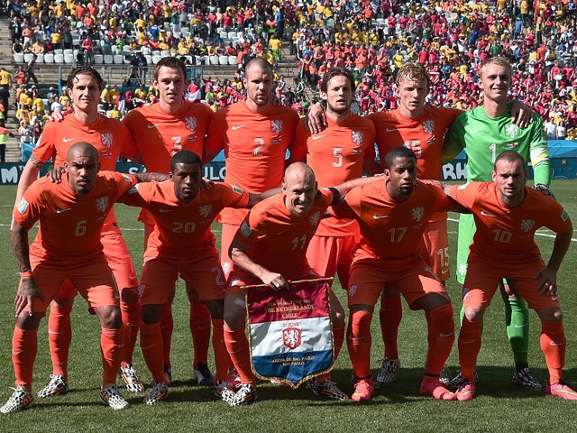 Members of the Netherlands' national team pose for the team photo prior to the Group B football match between Netherlands and Chile at the Corinthians Arena in Sao Paulo during the 2014 FIFA World Cup on June 23, 2014