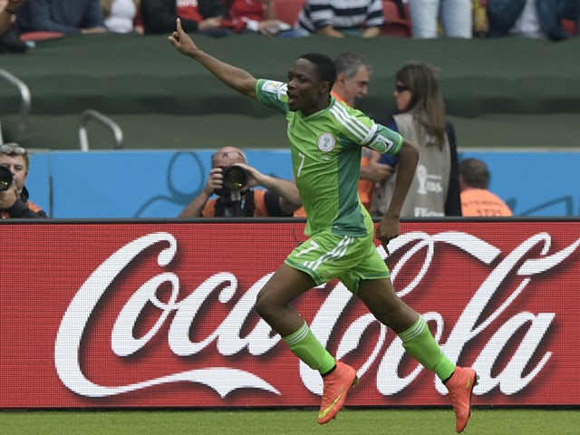 Nigeria's forward Ahmed Musa celebrates his second goal during a Group F football match between Nigeria and Argentina at the Beira-Rio Stadium in Porto Alegre during the 2014 FIFA World Cup on June 25, 2014