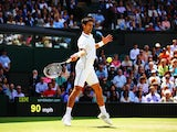 Novak Djokovic of Serbia plays a forehand return during his Gentlemen's Singles third round match against Gilles Simon of France on day five of the Wimbledon Lawn Tennis Championships at the All England Lawn Tennis and Croquet Club on June 27, 2014