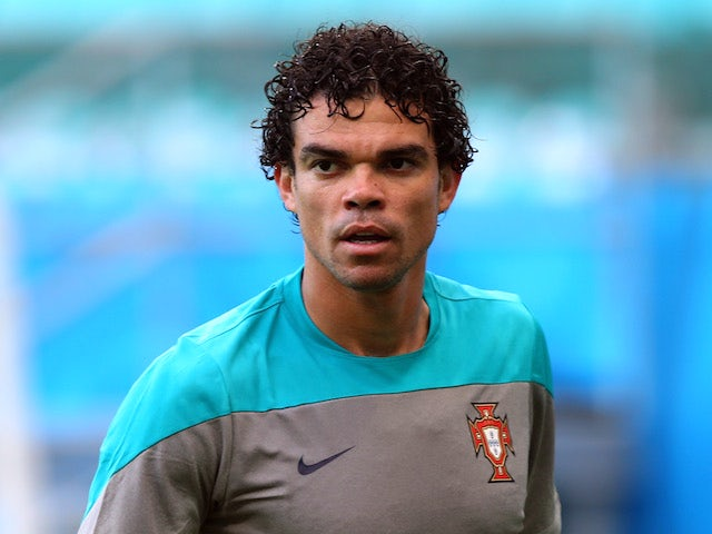 Pepe reacts during the Portugal training session ahead of the 2014 FIFA World Cup Group G match between Germany and Portugal held at the Arena Fonte Nova on June 15, 2014