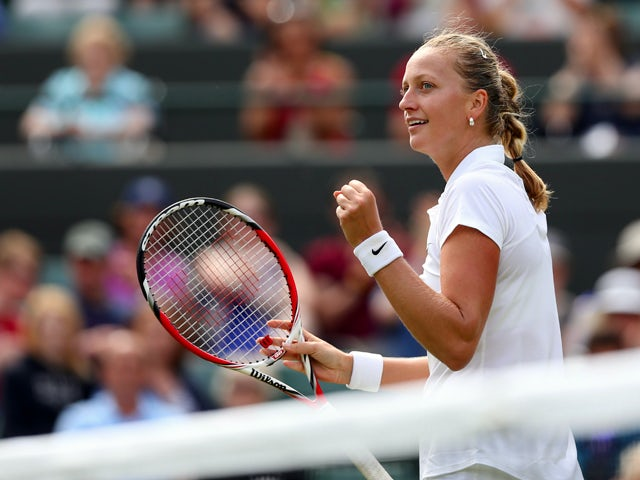 Petra Kvitova of Czech Republic celebrates after winning her Ladies' Singles second round match against Mona Barthel of Germany on day three of the Wimbledon Lawn Tennis Championships at the All England Lawn Tennis and Croquet Club at Wimbledon on June 2