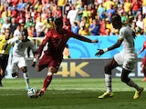 Portugal's forward and captain Cristiano Ronaldo scores during the Group G football match between Portugal and Ghana at the Mane Garrincha National Stadium in Brasilia during the 2014 FIFA World Cup on June 26, 2014