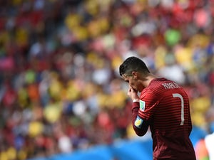 Portugal's forward and captain Cristiano Ronaldo reacts during the Group G football match between Portugal and Ghana at the Mane Garrincha National Stadium in Brasilia during the 2014 FIFA World Cup on June 26, 2014