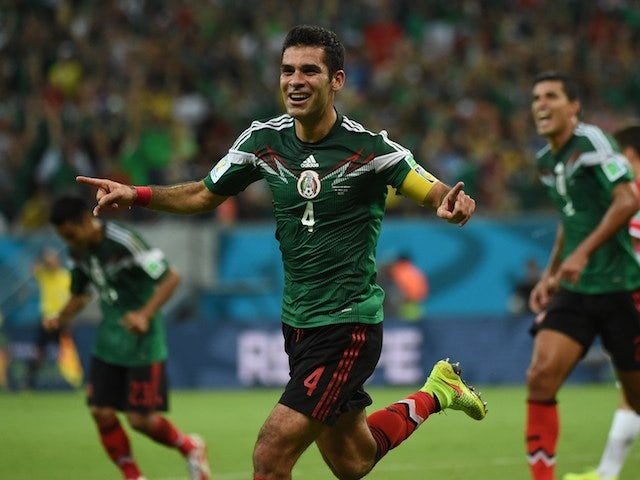 Mexico's defender Rafael Marquez celebrates after scoring during a Group A football match between Croatia and Mexico at the Pernambuco Arena in Recife during the 2014 FIFA World Cup on June 23, 2014