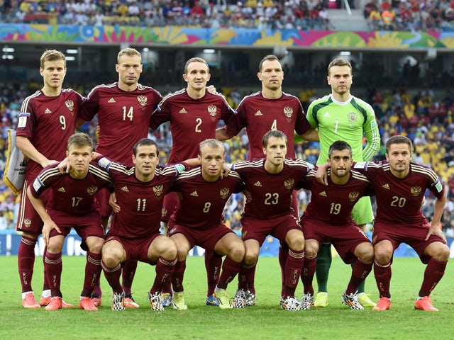 Russia pose for a team photo prior to the 2014 FIFA World Cup Brazil Group H match between Algeria and Russia at Arena da Baixada on June 26, 2014