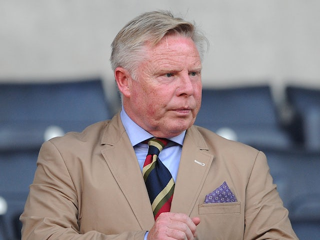 Bolton Wanderers coach Sammy Lee looks on during a pre-season friendly at the Reebok Stadium on July 26, 2013