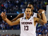 Shabazz Napier #13 of the Connecticut Huskies celebrates on the court after defeating the Kentucky Wildcats 60-54 in the NCAA Men's Final Four Championship on April 7, 2014