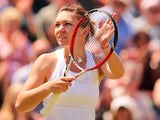 Romania's Simona Halep celebrates beating Ukraine's Lesia Tsurenko during their women's singles second round match on day five of the 2014 Wimbledon Championships at The All England Tennis Club in Wimbledon, southwest London, on June 27, 2014