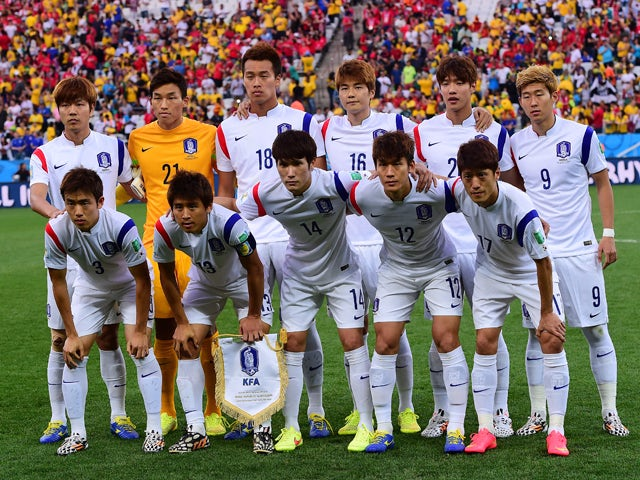 South Korea's players pose prior to a Group H football match between South Korea and Belgium at the Corinthians Arena in Sao Paulo during the 2014 FIFA World Cup on June 26, 2014