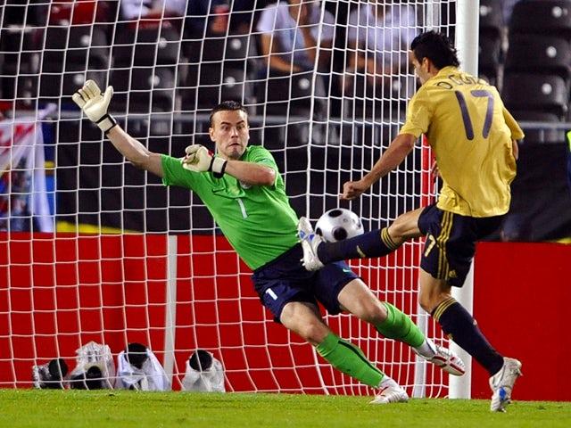 Spanish forward Daniel Guiza taps the ball past Russian goalkeeper Igor Akinfeev to score during the Euro 2008 championships semi-final football match Russia vs. Spain on June 26, 2008