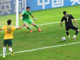 David Villa of Spain scores his team's first goal with a back heel past Mathew Ryan of Australia during the 2014 FIFA World Cup Brazil Group B match between Australia and Spain at Arena da Baixada on June 23, 2014