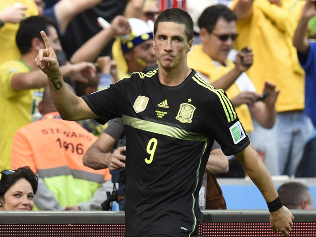 Spain's forward Fernando Torres celebrates after scoring his team's second goal during a Group B match between Australia and Spain at the Baixada Arena in Curitiba during the 2014 FIFA World Cup on June 23, 2014