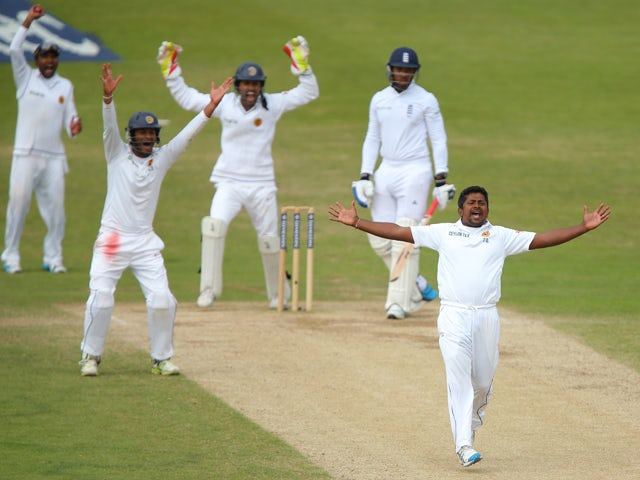 Rangana Herath of Sri Lanka appeals successfully for the wicket of Chris Jordan of England during day five of the 2nd Investec Test match between England and Sri Lanka at Headingley Cricket Ground on June 24, 2014