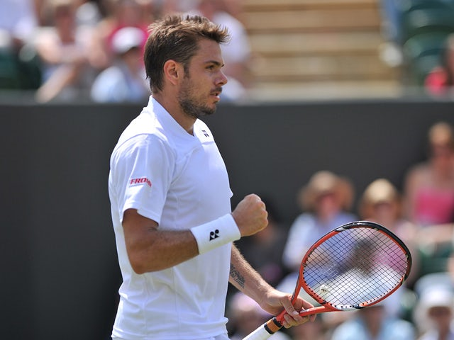 Switzerland's Stanislas Wawrinka reacts after a point against Portugal's Joao Sousa during their men's singles first round match on day two of the 2014 Wimbledon Championships at The All England Tennis Club in Wimbledon, southwest London, on June 24, 2014