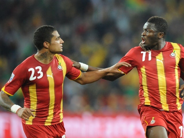Ghana's midfielder Sulley Muntari (C) celebrates with Ghana's striker Kevin-Prince Boateng celebrate during the 2010 World Cup QF match on July 2, 2010