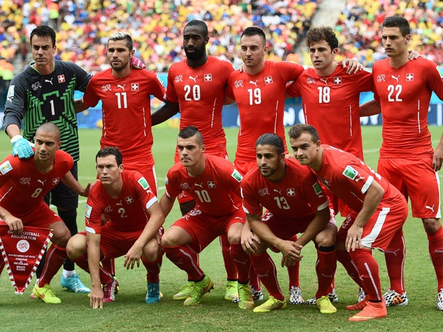 Switzerland's squad pose for a group picture before the start of the Group E football match between Honduras and Switzerland at the Amazonia Arena in Manaus during the 2014 FIFA World Cup on June 25, 2014