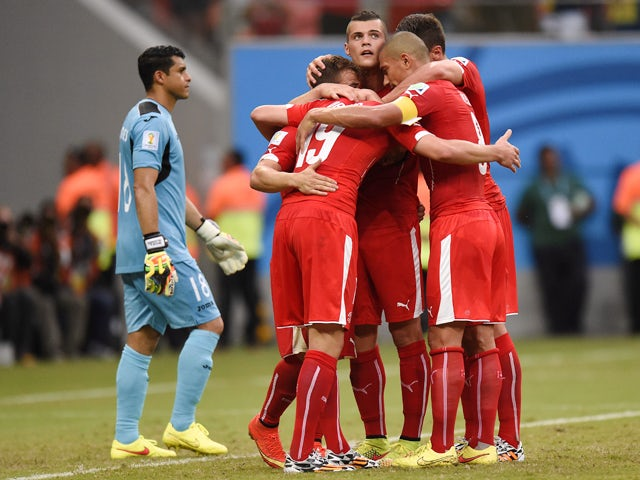 Switzerland's players celebrate after scoring their third goal during the Group E football match between Honduras and Switzerland at the Amazonia Arena in Manaus during the 2014 FIFA World Cup on June 25, 2014