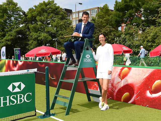 HSBC ambassadors, former British No.1, Tim Henman and former Wimbledon Champion Lindsay Davenport pose for photos at HSBC Court 20 on day one of The Championships on June 23, 2014