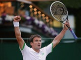 Spain's Tommy Robredo celebrates winning his men's singles third round match against Poland's Jerzy Janowicz on day six of the 2014 Wimbledon Championships at The All England Tennis Club in Wimbledon, southwest London, on June 28, 2014