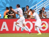 Uruguay's defender Diego Godin celebrates scoring with his teammates during the Group D football match between Italy and Uruguay at the Dunas Arena in Natal during the 2014 FIFA World Cup on June 24, 2014